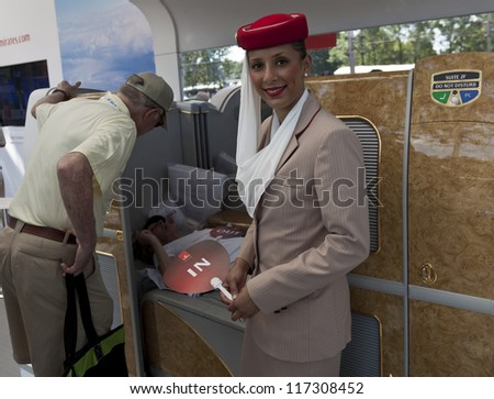 NEW YORK - AUGUST 28: Emirates airline shows off seat for business class flight to Dubai at US Open tennis tournament on August 28, 2012 in Flushing Meadows New York - stock photo
