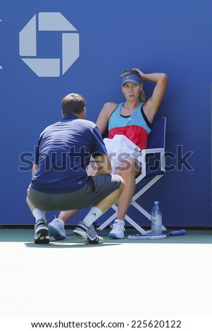 NEW YORK - AUGUST 19: Five times Grand Slam champion Maria Sharapova with her coach Sven Groeneveld during practice for US Open 2014 at Arthur Ashe Stadium on August 19, 2014 in New York - stock photo