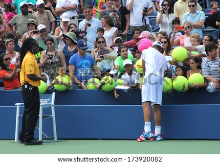 NEW YORK - AUGUST 25 Grand Slam champion Andy Roddick signing autographs after practice for US Open 2012 at Billie Jean King National Tennis Center on August 25, 2012 in New York - stock photo