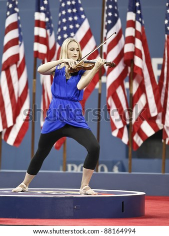 NEW YORK - AUGUST 29: Jane Hunt Violin Venus performs during opening ceremony at USTA Billie Jean King National Tennis Center on August 29, 2011 in NYC