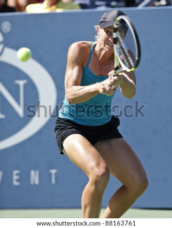 NEW YORK - AUGUST 29: Jill Graybas of USA returns ball during 1st round match against Madison Keys of USA at USTA Billie Jean King National Tennis Center on August 29, 2011 in NYC