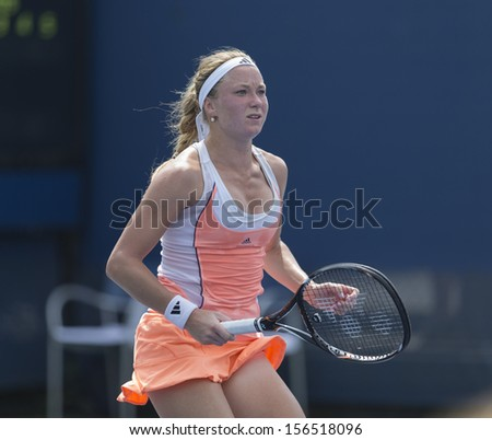NEW YORK - AUGUST 31: Julia Glushko of Israel reacts during 3rd round match against Daniela Hantuchova of Slovakia at 2013 US Open at USTA Billie Jean King Tennis Center on August 31, 2013 in NYC - stock photo