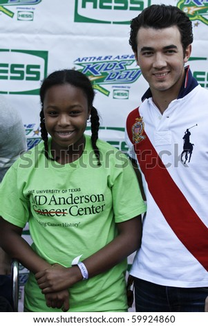 NEW YORK - AUGUST 28: Kevin of The Jonas Brothers and unidentified cancer patient arrive at the Arthur Ashe Kids Day at US Open August 28, 2010 in New York City - stock photo