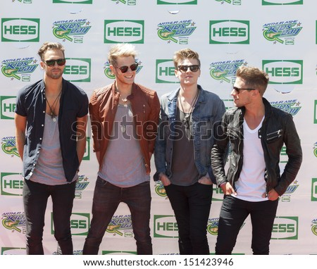 NEW YORK - AUGUST 24: (L-R) Andy Brown, Ryan Fletcher, Joel Peat and Adam Pitts of Lawson attend the 2013 Arthur Ashe Kids Day at USTA Billie Jean King National Tennis Center on August 24, 2013 in NYC - stock photo