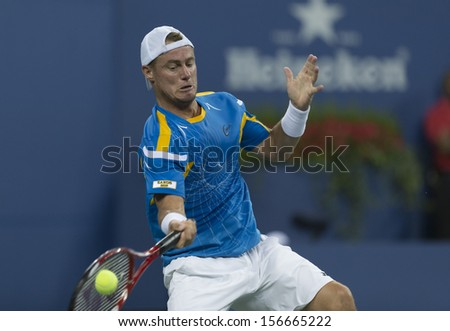 NEW YORK - AUGUST 30: Lleyton Hewitt of Australia returns ball during 2nd round match against Juan Martin Del Potro of Argentina at 2013 US Open at USTA Center on August 30, 2013 in New York - stock photo