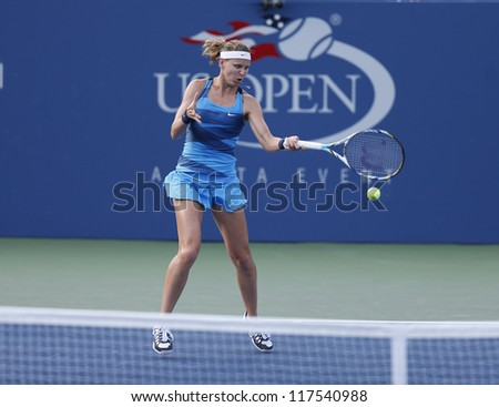NEW YORK - AUGUST 27: Lucie Safarova of Czech Republic returns ball during 1st round match against Melanie Oudin of USA at US Open tennis tournament on August 27, 2012 in Flushing Meadows New York