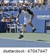 NEW YORK - AUGUST 31: Marcos Baghdatis of Cyprus returns ball during match against Arnaud Clement of France at US Open tennis tournament on August 31, 2010, New York. - stock photo