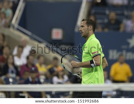 NEW YORK - AUGUST 28: Michael Llodra of France reacts during 1st round match against Andy Murray of Great Britain at 2013 US Open at USTA Billie Jean King Tennis Center on August 28, 2013 in New York - stock photo