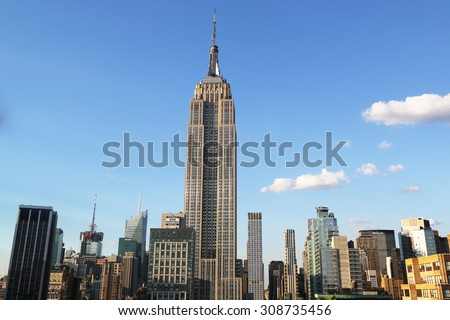NEW YORK - AUGUST 1, 2015: Midtown Manhattan aerial view with Empire State Building. The Empire State Building is a 102-story landmark and was world's tallest building for more than 40 years.  - stock photo
