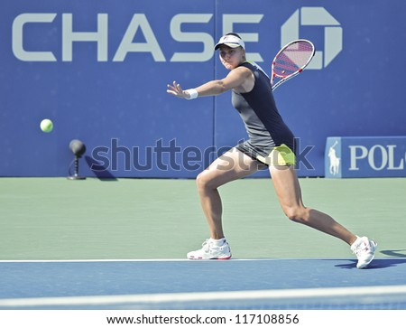 NEW YORK - AUGUST 31: Nadia Petrova of Russia returns ball during 2nd round match against Lucie Safarova of Czech Republic at US Open tennis tournament on August 31, 2012 in Flushing Meadows New York