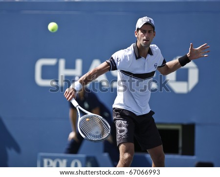 NEW YORK - AUGUST 31: Novak Djokovic of Serbia returns ball during first round match against Victor Troicki of Serbia at US Open tennis tournament on August 31, 2010, New York.