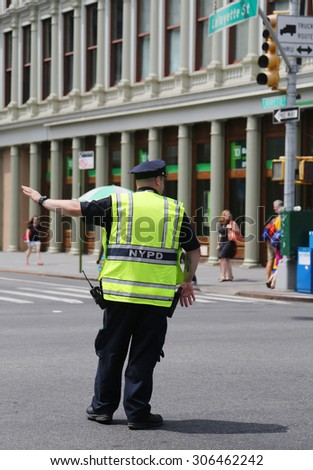 NEW YORK - AUGUST 8, 2015: NYPD Traffic Control Police Officer in Lower Manhattan  - stock photo