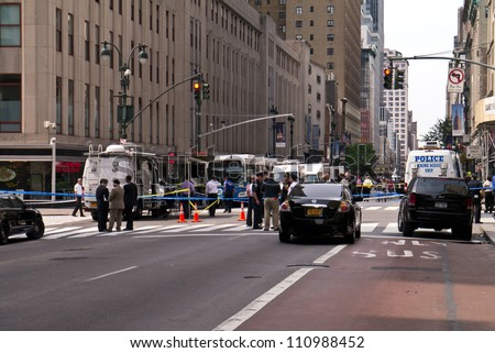 NEW YORK - AUGUST 24:  People and Media gather one block away after 2 killed and 8 injured in shooting near Empire State Building August 24, 2012  in New York City
