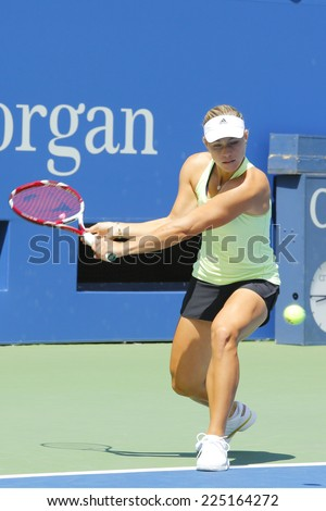 NEW YORK - AUGUST 19 Professional tennis player Angelique Kerber from Germany practices for US Open 2014 at Billie Jean King National Tennis Center on August 19 , 2014 in New York - stock photo