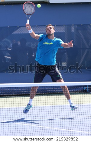 NEW YORK - AUGUST 24: Professional tennis player Marin Cilic practices for US Open 2014 at Billie Jean King National Tennis Center on August 24 , 2014 in New York  - stock photo