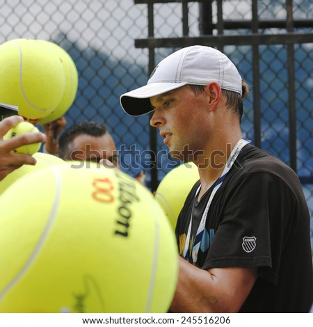 NEW YORK - AUGUST 31, 2014: Professional tennis player Mike Bryan signing autographs after practice for US Open 2014 at Billie Jean King National Tennis Center in New York  - stock photo