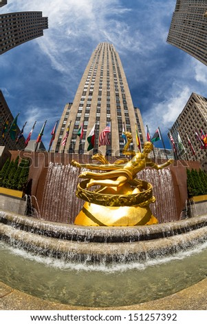NEW YORK - AUGUST 09: Prometheus statue at Rockefeller Center on 5th Avenue on August 09 , 2013 in New York City. The sculpture was made in 1934 by sculptor Paul Manship. - stock photo
