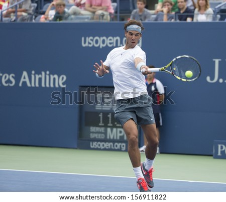 NEW YORK - AUGUST 26: Rafael Nadal of Spain returns ball during 1st round match against Ryan Harrison of USA at 2013 US Open at USTA Billie Jean King Tennis Center on August 26, 2013 in NYC - stock photo