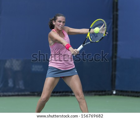 NEW YORK - AUGUST 27: Roberta Vinci of Italy returns ball during 1st round match against Timea Babos of Hungary at 2013 US Open at USTA Billie Jean King Tennis Center on August 27, 2013 in NYC
