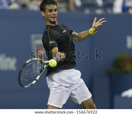 NEW YORK - AUGUST 29: Rogerio Dutra Silva of Brazil returns ball during 2nd round match against Rafael Nadal of Spain at 2013 US Open at USTA Billie Jean King Tennis Center on August 29, 2013 in NYC - stock photo
