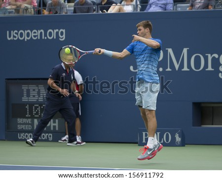 NEW YORK - AUGUST 26: Ryan Harrison of USA returns ball during 1st round match against Rafael Nadal of Spain at 2013 US Open at USTA Billie Jean King Tennis Center on August 26, 2013 in NYC - stock photo