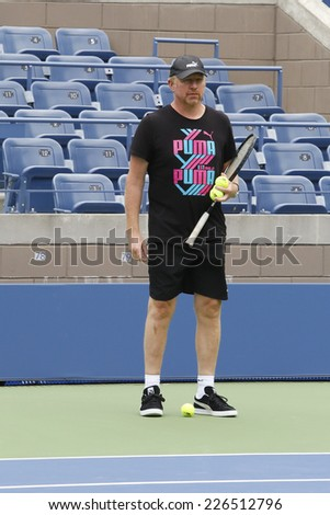 NEW YORK - AUGUST 21: Six times Grand Slam champion Boris Becker coaching Novak Djokovic for US Open 2014 at Billie Jean King National Tennis Center on August 21, 2014 in New York - stock photo