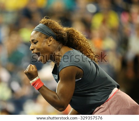 NEW YORK - AUGUST 29, 2015:Sixteen times Grand Slam champion Serena Williams during US Open 2013 first round doubles match with teammate Venus Williams at Billie Jean King National Tennis Center in NY - stock photo