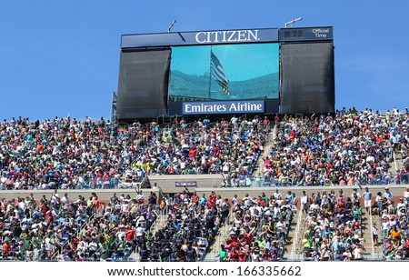 NEW YORK -AUGUST 24:Spectators standing at Arthur Ashe Stadium for American anthem performance during opening ceremony for Arthur Ashe Kids Day 2013 at  National Tennis Center on August 24, 2013 in NY - stock photo