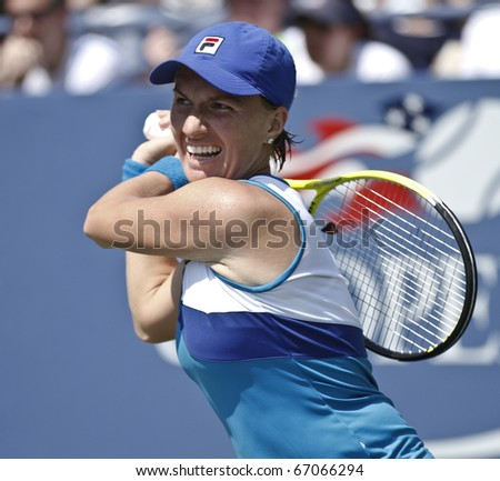 NEW YORK - AUGUST 31: Svetlana Kuznetsova of Russia returns a ball during math against Kimiko Date Krumm of Japan at US Open tennis tournament on August 31, 2010, New York. - stock photo
