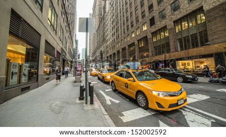 NEW YORK - AUGUST 20: taxi cabs on August 20, 2013 in New York. Yellow taxis are an iconic part of the NYC landscape, and are able to pick up passengers anywhere in any of the five boroughs. - stock photo