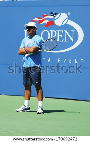 NEW YORK - AUGUST 25 Tennis coach Toni Nadal during Rafael Nadal practice for US Open 2013 at Arthur Ashe Stadium at Billie Jean King National Tennis Center on August 25, 2013 in New York - stock photo
