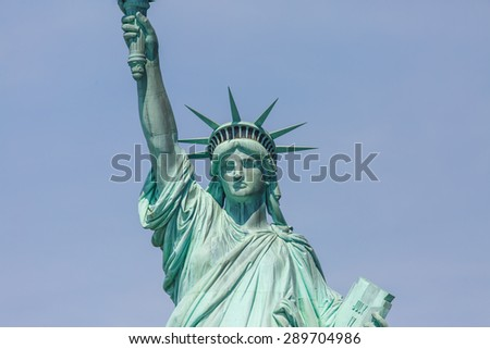 NEW YORK - AUGUST 2014: View of Statue of Liberty on August 11, 2014 in Manhattan, NY. Statue of Liberty is one of the most recognizable landmark of New York City and one of the symbols of USA. - stock photo