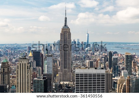 NEW YORK - AUGUST 23: View to Downtown Manhattan with the famous Empire State Building on August 23, 2015. This view is from the rooftop of an another skyscraper. - stock photo