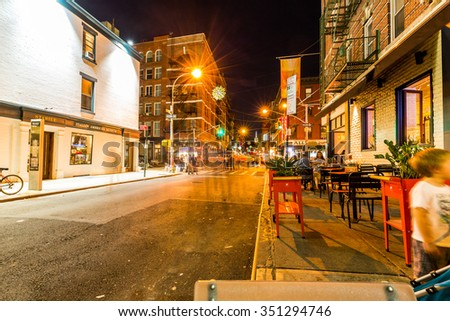 NEW YORK - AUGUST 22: View to the Mulberry Street at night in New York on August 22, 2015. The Mulberry Street is in the district called Little Italy, Manhattan. - stock photo