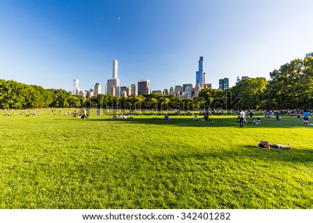 NEW YORK - AUGUST 22: Views of the from the big meadow Central Park to Midtown New York on August 22, 2015. The Central Park is a famous Park in the centre of Manhattan, New York.