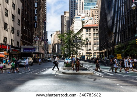 NEW YORK - AUGUST 22: Views of the rush streets of Manhattan at 7th Avenue on August 22, 2015. Its on the intersection of W53 Street near the Times Square.