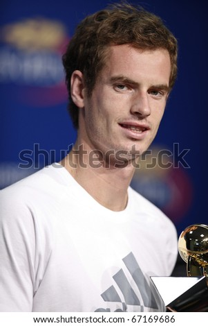 NEW YORK - AUGUST 30: Winner of US Open Series tennis tournaments Andy Murray of United Kingdom posing with trophy at US Open tennis tournament on August 30, 2010, New York.