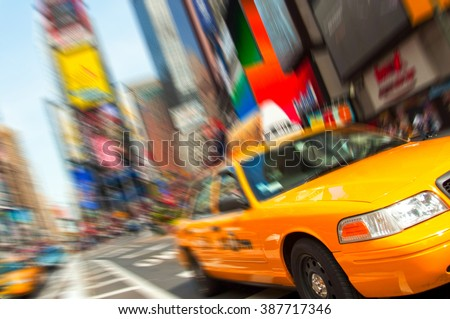 NEW YORK - AUGUST 28: Yellow taxi cabs rush tourists around Times Square on August 28, 2009 in New York City, NY. - stock photo