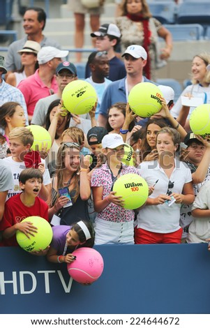 NEW YORK - AUGUST 30: Young tennis fans waiting for autographs at Billie Jean King National Tennis Center on August 30, 2014 in New York. US Open is a final Grand Slam tournament of the year - stock photo
