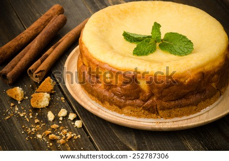 New york cheese cake on wooden background - stock photo