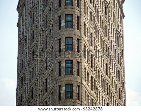 NEW YORK - CIRCA JULY 2009: The Flatiron Building circa July 2009 in New York City, USA. Flatiron building is considered to be one of the first skyscrapers ever built. - stock photo