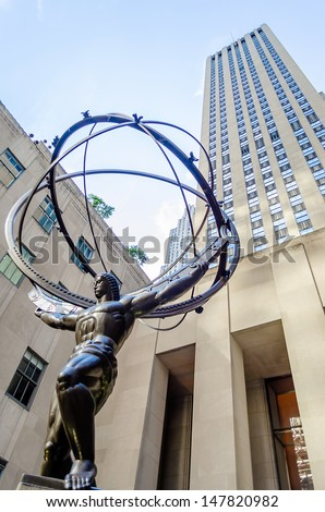 NEW YORK - CIRCA MAY 2013:: The historic Atlas Statue in the Rockefeller Center, New York, circa May 2013. It stands for power in the 5thAve where is located the most expensive stores of Manhattan,NYC - stock photo