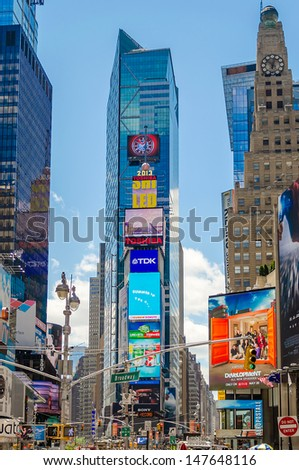 "NEW YORK - CIRCA MAY 2013: Times Square, New York, circa May 2013. It's a major commercial intersection, iconified as ""The Crossroads of the World"", it's also the hub of the Broadway Theater District"