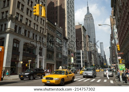 NEW YORK - CIRCA SEPTEMBER 2014: Empire State Building and manhattan street traffic