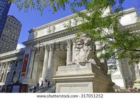 NEW YORK - CIRCA SEPTEMBER 2015. The New York Public Library on Fifth Avenue while being an active library filled with students is also a main tourist attraction for visitors in Manhattan. - stock photo
