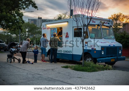 NEW YORK CITU, USA - JUNE 15, 2016: Vintage ice cream van car serving ice cream to the street customers. Man selling ice cream to people from car window,