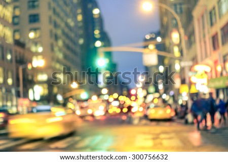 New york City abstract rush hour - Defocused yellow taxi cabs and traffic jam on 5th avenue in Manhattan downtown at blue hour - Blurred bokeh postcard on a retro vintage nostalgic filtered look - stock photo