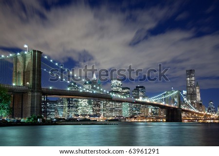New York City and Brooklyn Bridge at night - stock photo