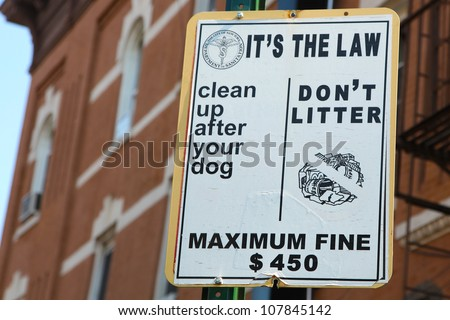 New York City Anti-Litter Sign Listing Fines & Urging to Curb Dogs - stock photo