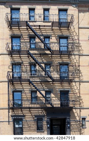 New York City apartment building and firescape - stock photo